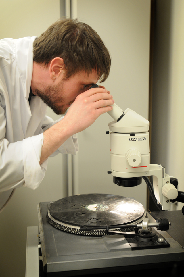Examination of a damaged lacquer disc in our sound labs