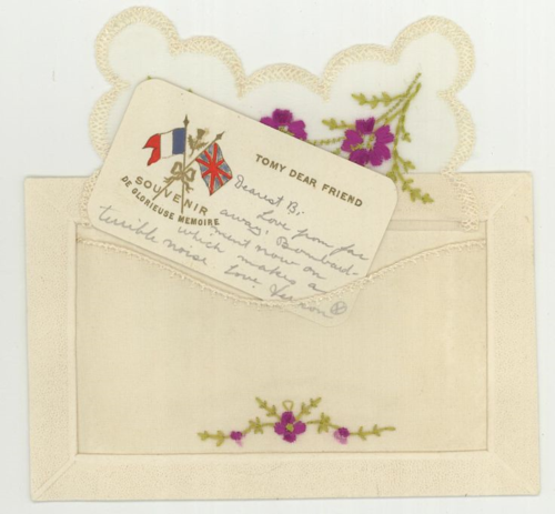 WW1 Silk embroidered postcard with insert. Flowers on front longer letter on back