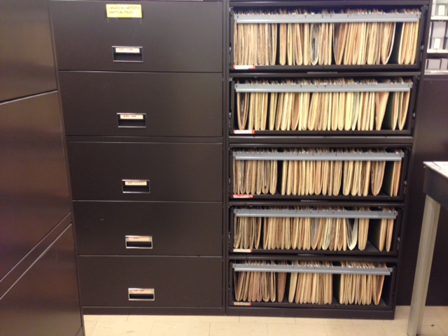 Canadian artist filing cabinet open showing files.