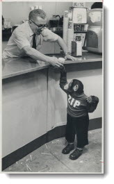 One on the house is received by Zippy the chimpanzee from Joe Pinsk at Dinty Moore's snack bar in the CNE's Coliseum where the Canadian National Sportsmen's Show opens today