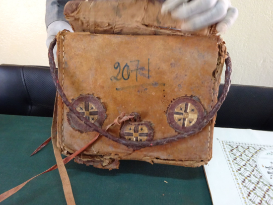 A saddlebag Qur'an, very similar to British Library Or.16751 on view in the British Library exhibition West Africa: Word, Symbol, Song (© IRSH, Université Abdou Moumouni)
