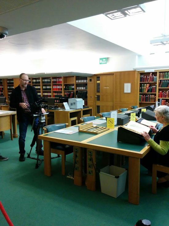 Matt Casswell filming Lead Curator Ilana Tahan browsing through a 15th-century censored manuscript (Arba'ah Ṭurim by Jacob ben Asher, British Library Add MS 27150) in the Asia & Africa Studies Reading Room