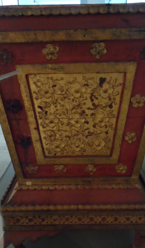 Wooden manuscript chest from Lanna or Shan State decorated with red lacquer, raised gilt lacquer as well as carved and gilt wooden applications, 19th century. British Library, F1060. Bequest from Doris Duke's Southeast Asian Art Collection.