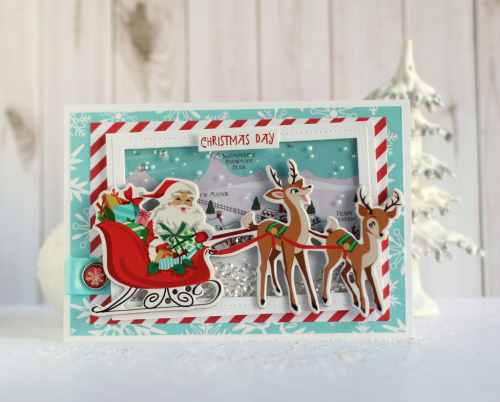 "Christmas Shaker Card by Anya Lunchko featuring the ""Santa's Workshop"" collection by #CartaBellaPaper"
