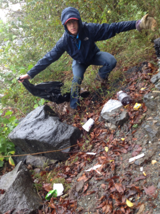 Student cleaning up trash. Credit Barclay Jumet
