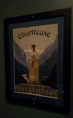 Alley Cat's appreciation of booze extends to the art on the wall of the men's room.