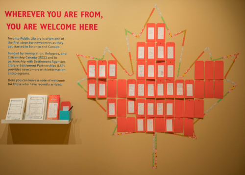 Wall in Destination Canada exhibit with notes of welcome from visitors