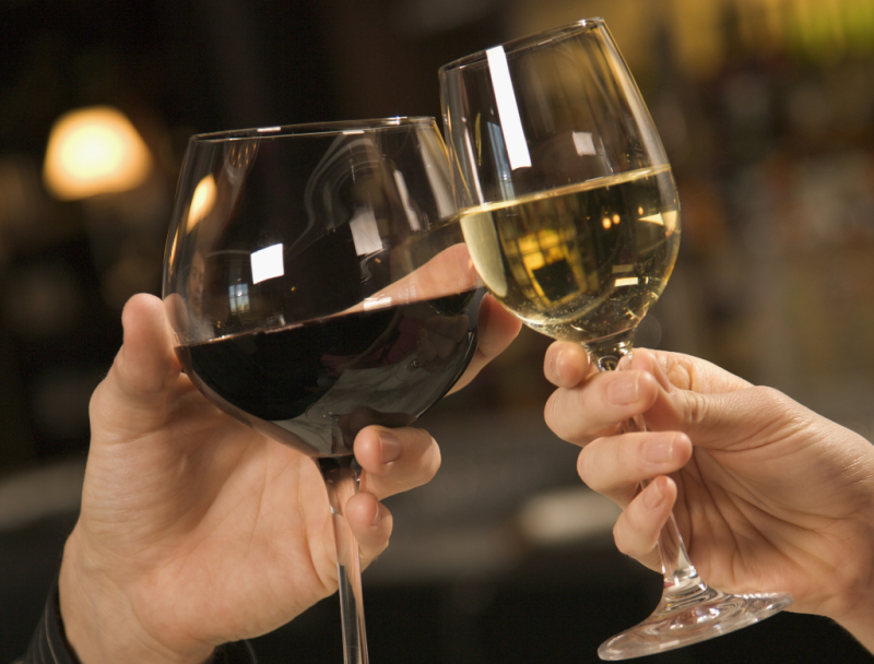 Hands holding wineglasses