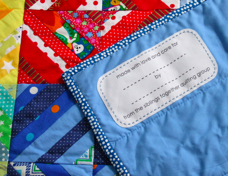 Each Siblings Together quilt is complete when a custom printed label is added to the blanket!