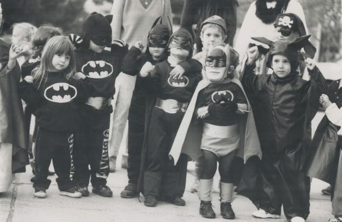 Group of children wearing Halloween costumes