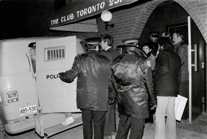 Men being led into a police van after the raid on The Club, 1981